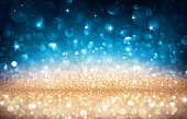 Glitter Lights Golden And Blue In Christmas Backdrop