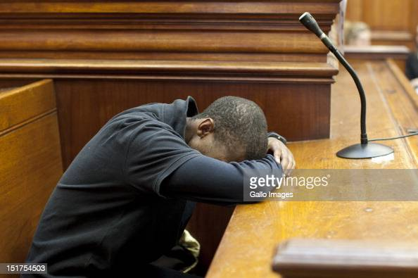 Xolile Mngeni appears at the Cape Town High Court on September 3 2012 in Cape Town South Africa He is accused of being involved in the murder of Anni...