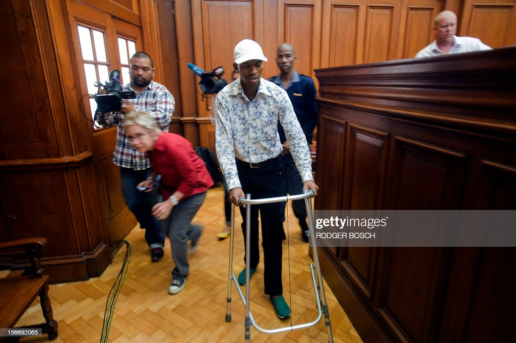 Xolile Mngeni, the man accused of killing Swedish honeymooner Anni Dewani, walks with a Zimer frame as he arrives into the Cape Town's High Court on November 19, 2012, to hear judgment. Mngeni has suffered from a brain tumour, which was removed before the case started. Mngeni claimed innocence in the November 2010 killing but admitted to his palm print having been found on the car in which Dewani's lifeless body was found in a poor Cape Town township. State prosecutor told Mngeni that his claims of not being at the murder scene were lies, as witnesses had testified otherwise and claimed that he had pulled the trigger. The 25-year-old had also been found in possession of items taken from Dewani and the honeymooning couple's taxi driver and had pointed out key details of the slaying to police after his arrest, prosecutor said.
