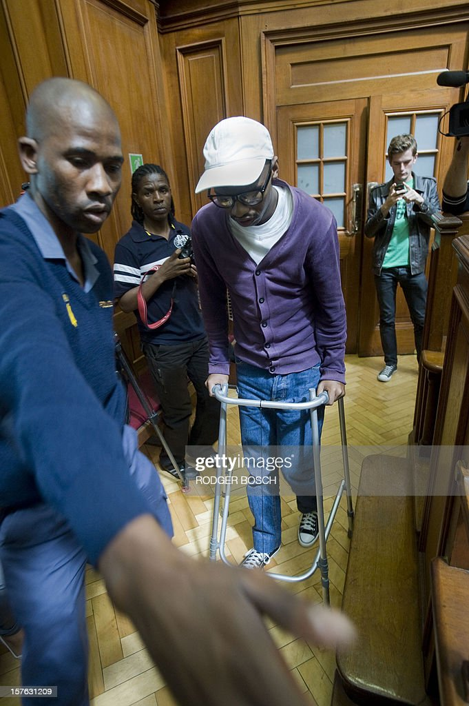 Xolile Mngeni, the man convicted of firing the bullet that killed Swedish tourist, Anni Dewani, in a simulated hijacking in Khayelitsha in 2011 walks with a Zimmer Frame into the High Court of Cape Town on December 5, 2012 for the final sentencing. Mngeni has been sentenced to life imprisonment on the charges of murder, robbery and illegal possession of a firearm and ammunition in the Cape High Court after being cleared as fit to stand trial despite his brain tumour. Dewani's husband, Shrien is fighting against being extradited from the UK to South Africa, allegedly for masterminding his wife's murder on November 13, 2011 in a poor township on the outskirts of Cape Town. AFP PHOTO / RODGER BOSCH