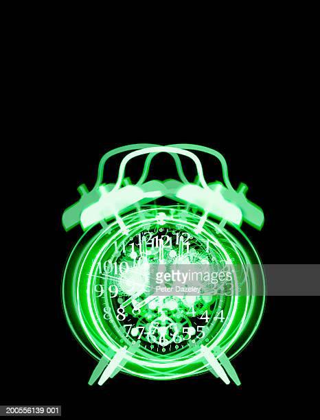 X-ray image of vibrating alarm clock on black background