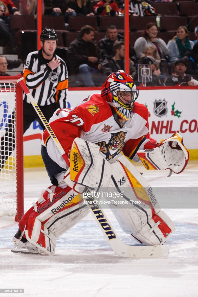 XScott Clemmensen of the Florida Panthers guards his net against the the Ottawa Senators during an NHL game at Canadian Tire Centre on December 19...