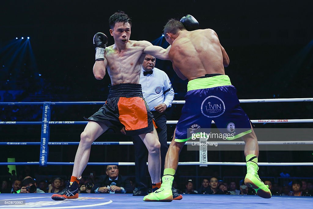 Xu Can of China delivers a punch to Corey McConnell of Australia during their WBA Super Featherweight Title battle match at Capital Indoor Stadium on June 24, 2016 in Beijing, China.