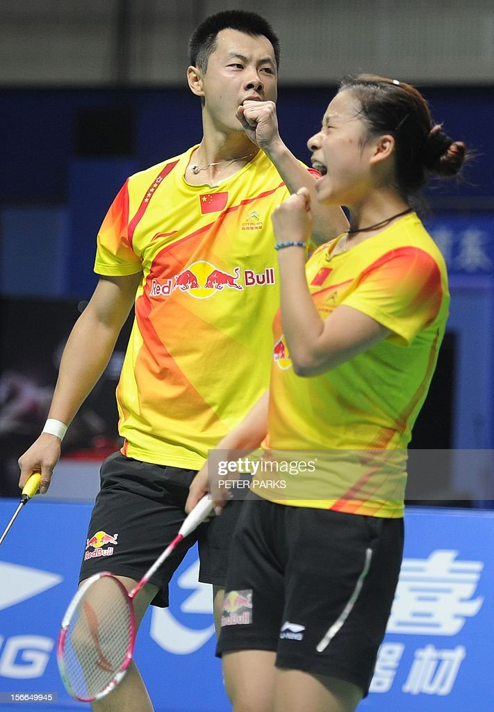 Xu Chen (L) and Ma Jin (R) of China celebrate beating Peng Soon Chan and Liu Ying Goh of Malaysia in the mixed doubles final at the China Open badminton tournament in Shanghai on November 18, 2012. AFP PHOTO / Peter PARKS
