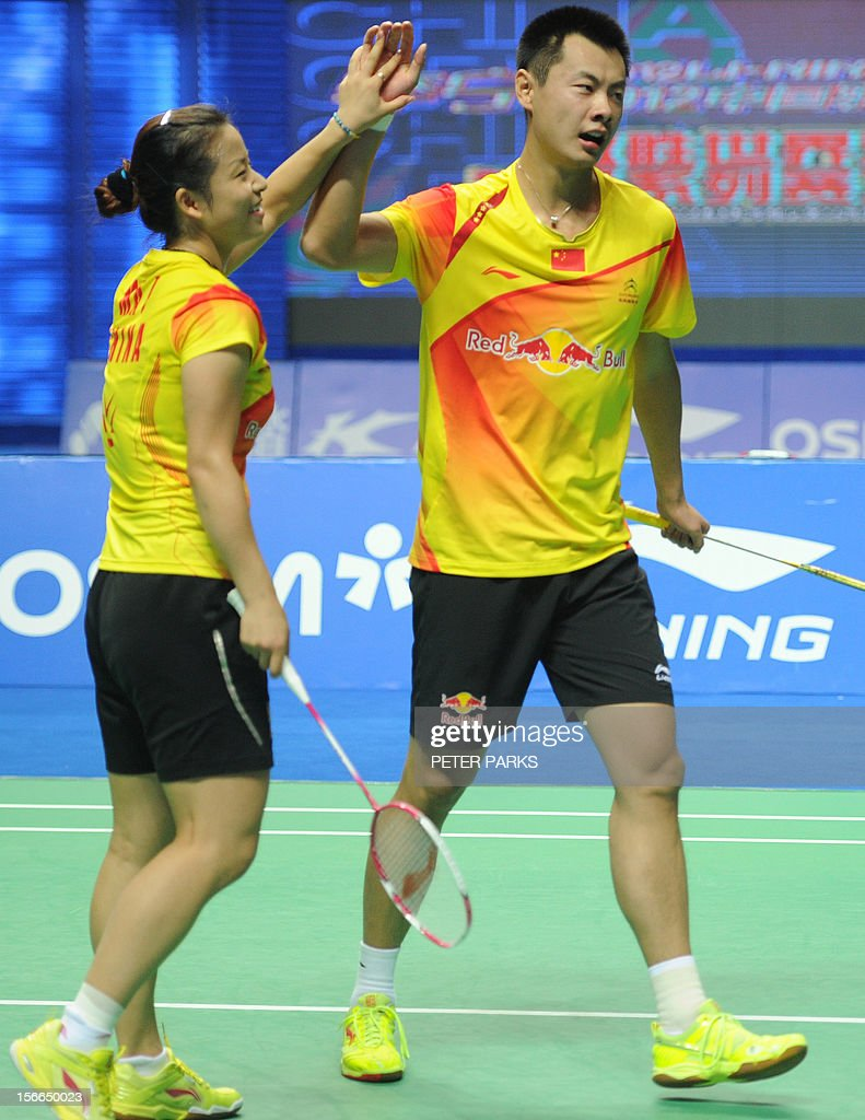 Xu Chen (R) and Ma Jin (L) of China celebrate beating Peng Soon Chan and Liu Ying Goh of Malaysia in the mixed doubles final at the China Open badminton tournament in Shanghai on November 18, 2012. AFP PHOTO / Peter PARKS