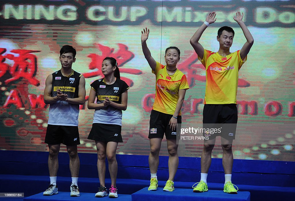Xu Chen (R) and Ma Jin (2nd R) of China celebrate beating Peng Soon Chan (L) and Liu Ying Goh (2nd L) of Malaysia in the mixed doubles final at the China Open badminton tournament in Shanghai on November 18, 2012. AFP PHOTO / Peter PARKS