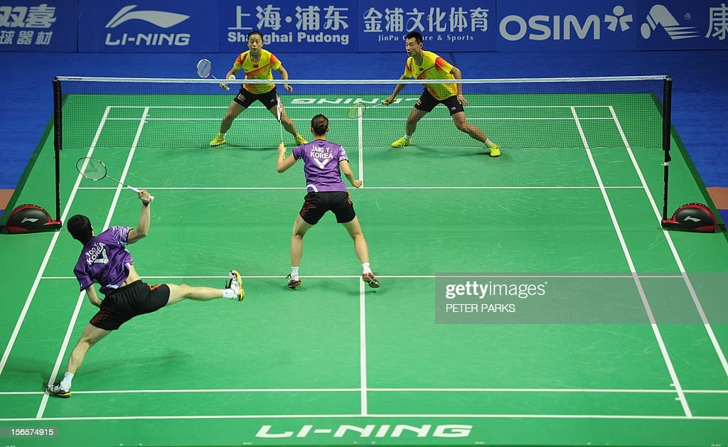 Xu Chen (Top-R) and Ma Jin (Top-L) of China compete against Jang Ye Na (Bottom-C) and Yoo Yeon Seong (Bottom-L) of South Korea in their mixed doubles semi-final match at the China Open badminton tournament in Shanghai on November 17, 2012. AFP PHOTO/Peter PARKS