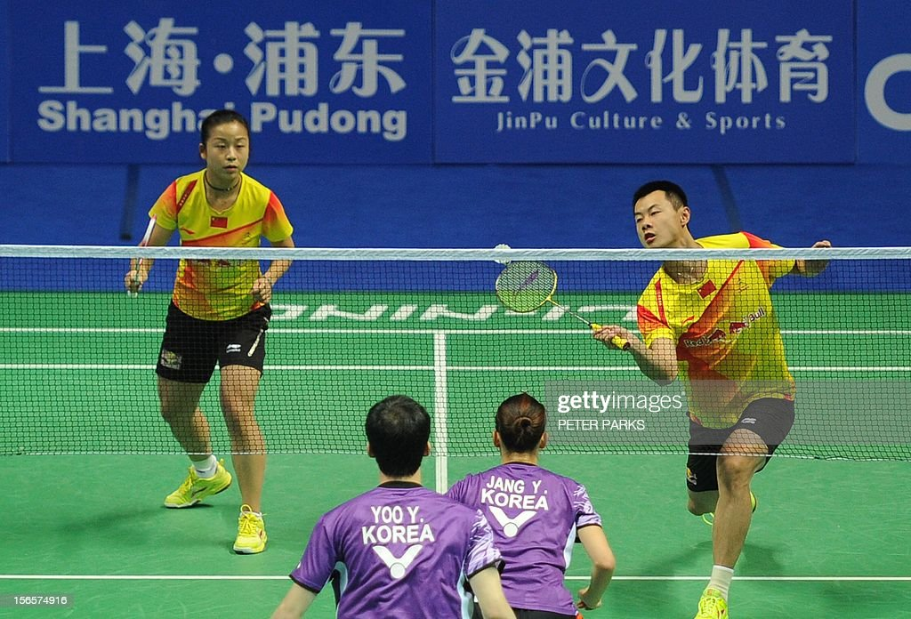 Xu Chen (Top-R) and Ma Jin (Top-L) of China compete against Jang Ye Na (Bottom-R) and Yoo Yeon Seong (Bottom-L) of South Korea in their mixed doubles semi-final match at the China Open badminton tournament in Shanghai on November 17, 2012. AFP PHOTO/Peter PARKS