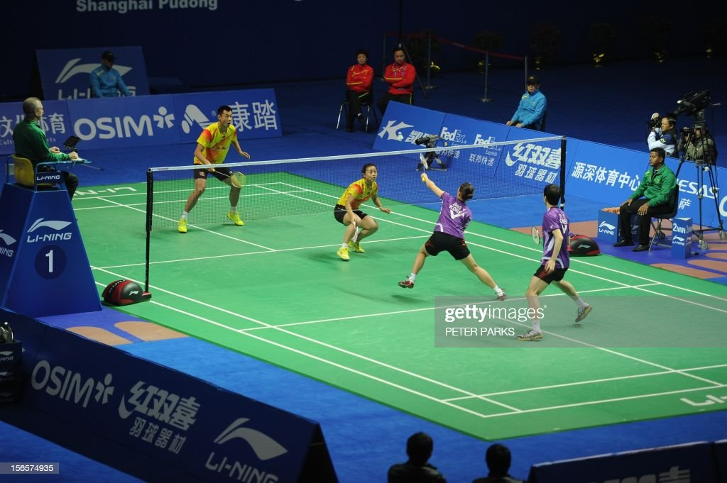 Xu Chen (L) and Ma Jin (2nd-L) of China compete against Jang Ye Na (2nd-R) and Yoo Yeon Seong (R) of South Korea in their mixed doubles semi-final match at the China Open badminton tournament in Shanghai on November 17, 2012. AFP PHOTO/Peter PARKS