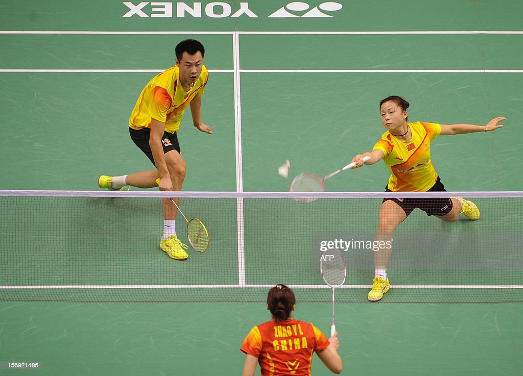 Xu Chen (L) and Ma Jin (R) of China compete against their compatriots Zhang Nan and Zhao Yunlei (lower) in the mixed doubles final at the Hong Kong Open badminton tournament on November 25, 2012. AFP PHOTO / Dale de la Rey