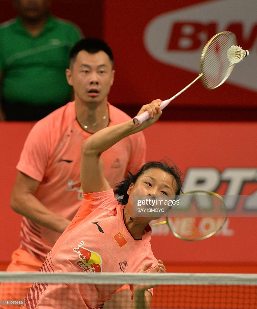 Xu Chen back and Ma Jin front of China hit a return against