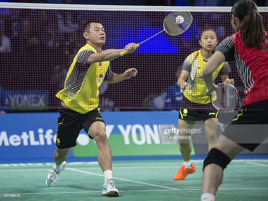 Xu Chen L and Ma Jin R of China in action against Liu Cheng