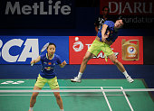 Xu Chen and Ma Jin of China play a shot against Joachim Fischer Nielsen and Christinna Pedersen of Denmark during the 2015 BCA Indonesia Open...