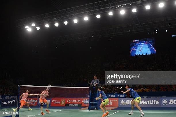 Xu Chen and Ma Jin of China play against Zhang Nan and Zhao Yunlei of China during the mixed doubles final of the Indonesia Open badminton tournament...