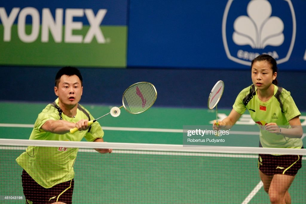 Xu Chen and <a gi-track='captionPersonalityLinkClicked' href=/galleries/search?phrase=Ma+Jin&family=editorial&specificpeople=5747194 ng-click='$event.stopPropagation()'>Ma Jin</a> of China return a shot against Joachim Fischer Nielsen and Christinna Pedersen of Denmark during the Mix Doubles final BCA Indonesia Open 2014 MetLife BWF World Super Series Premier at Istora Gelora Bung Karno Stadium on June 22, 2014 in Jakarta, Indonesia.