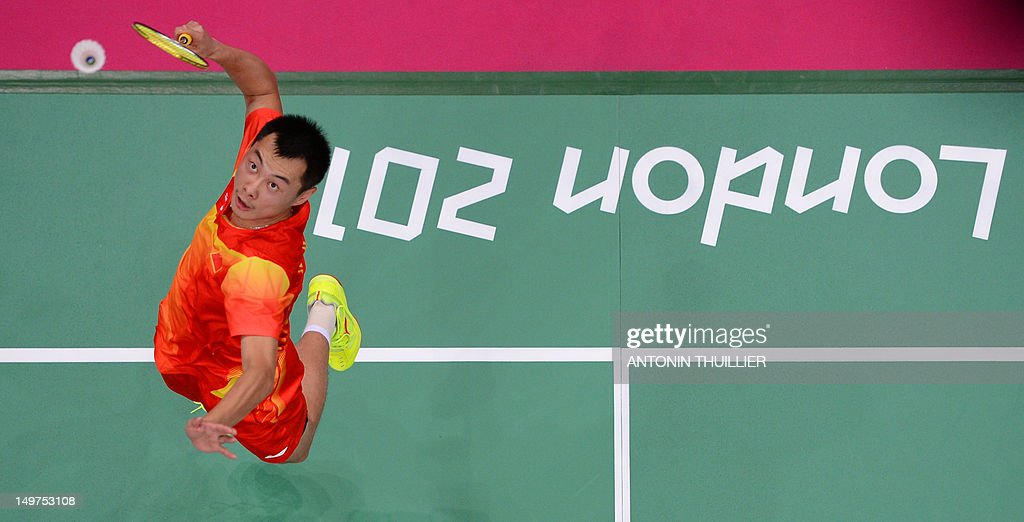 Xu Chen of China prepares to play a smash in his mixed doubles final badminton match with Ma Jin against compatriots Zhao Yunlei and Zhang Nan in London on August 3, 2012, for The 2012 London Olympic Games.
