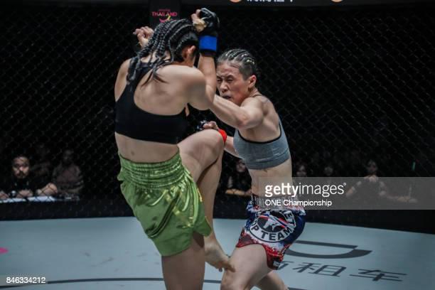 Xu Chun Yan outstrikes Eh Ya Nut during ONE Championship Shanghai at the Shanghai Oriental Sports Center on September 02 2017 in Shanghai China