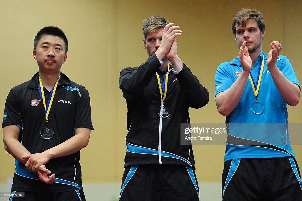 Xu Hui and Robert Svensson and Mattias Oversjo look dejected during the Table Tennis Champions League Final between Pontoise Cergy and Eslov on May 29, 2016 in Cergy-Pontoise, France.