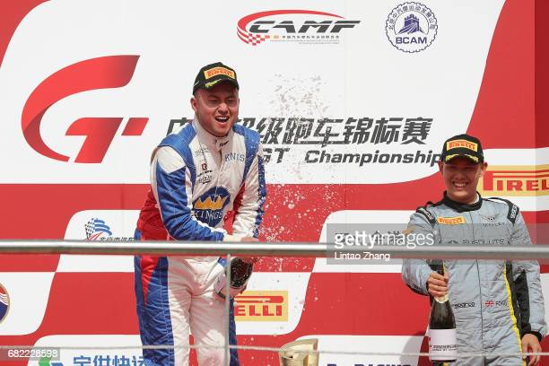 Xu Jia of China celebrate on the podium after winning the first round of the 2017 China GT Championship at Goldenport Motor Park on May 12 2017 in...