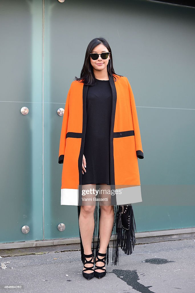 Xu Jing poses wearing a Fausto Puglisi coat during Milan Fashion Week on February 27 2015 in Milan Italy