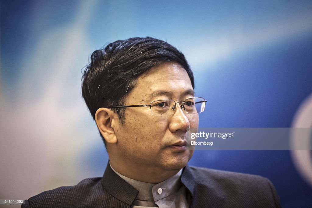 Xu Jinghong, chairman of Tsinghua Holdings Co. Ltd., pauses as he speaks during a Bloomberg Television interview on the sidelines of the World Economic Forum (WEF) Annual Meeting of the New Champions in Tianjin, China, on Sunday, June 26, 2016. The meeting runs through June 28. Photographer: Qilai Shen/Bloomberg via Getty Images
