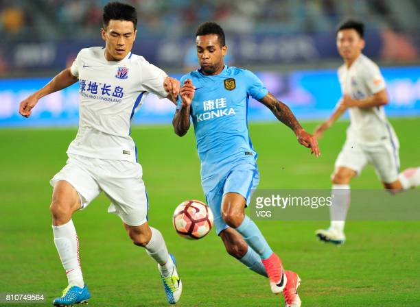Xu Junmin of Shanghai Shenhua and Alex Teixeira of Jiangsu Suning compete for the ball during the 16th round match of 2017 Chinese Football...