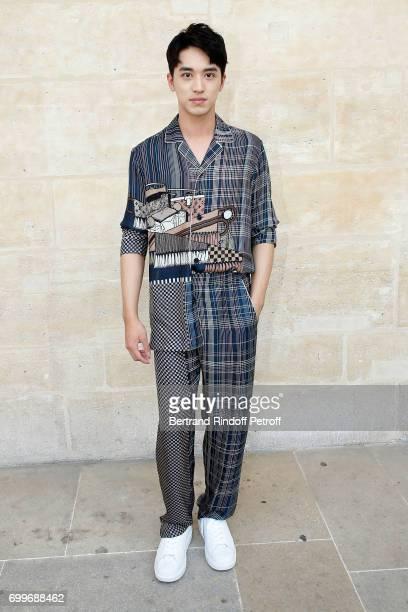 Xu Weizhou attends the Louis Vuitton Menswear Spring/Summer 2018 show as part of Paris Fashion Week on June 22 2017 in Paris France
