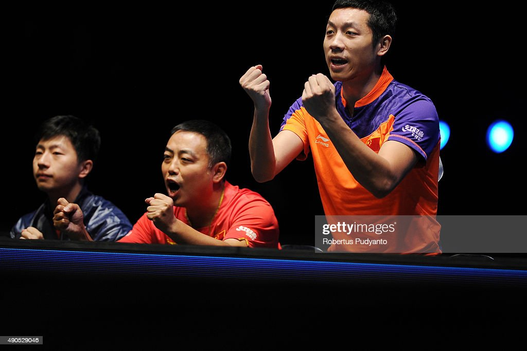 Xu Xin (R) and coach <a gi-track='captionPersonalityLinkClicked' href=/galleries/search?phrase=Liu+Guoliang&family=editorial&specificpeople=655363 ng-click='$event.stopPropagation()'>Liu Guoliang</a> (C) of China reacts after winning Men's Team Champion Division final match of the 22nd 2015 ITTF Asian Table Tennis Championships at Pattaya Sports Indoor Stadium on September 29, 2015 in Pattaya, Thailand.