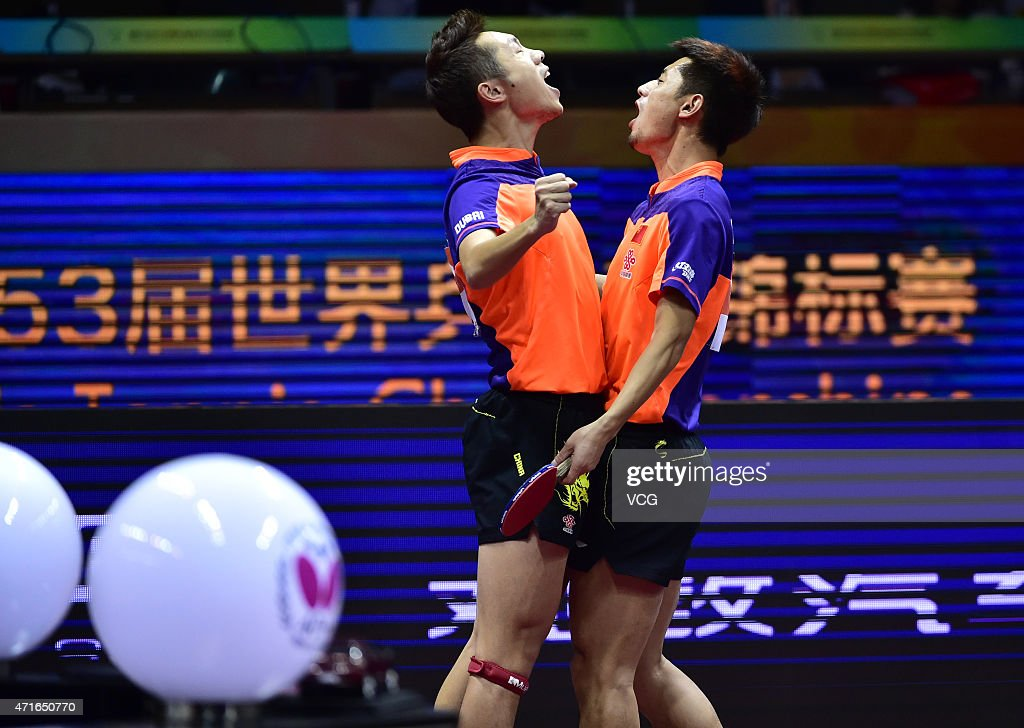 <a gi-track='captionPersonalityLinkClicked' href=/galleries/search?phrase=Xu+Xin+-+Table+Tennis+Player&family=editorial&specificpeople=15781496 ng-click='$event.stopPropagation()'>Xu Xin</a> (L) and <a gi-track='captionPersonalityLinkClicked' href=/galleries/search?phrase=Zhang+Jike+-+Table+Tennis+Player&family=editorial&specificpeople=4979400 ng-click='$event.stopPropagation()'>Zhang Jike</a> of China reacts after winning their Men's Doubles Quarter-final Match against Morizono Masataka and Oshima Yuya of Japan on day five of the 2015 World Table Tennis Championships at the Suzhou International Expo Center in Suzhou, Jiangsu province on April 30, 2015.