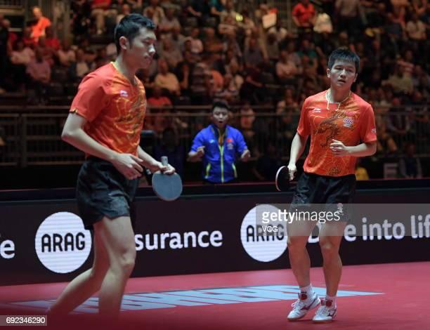Xu Xin of China and Fan Zhendong of China compete during Men's Doubles final match against Masataka Morizono of Japan and Yuya Oshima of Japan on day...