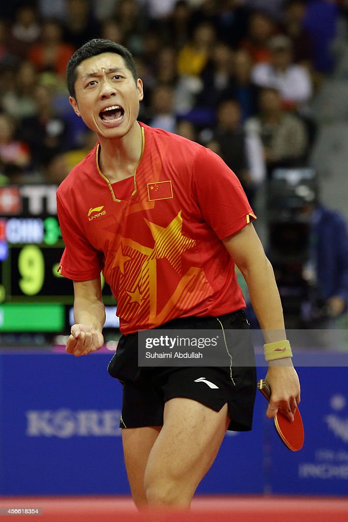 <a gi-track='captionPersonalityLinkClicked' href=/galleries/search?phrase=Xu+Xin+-+Table+Tennis+Player&family=editorial&specificpeople=15781496 ng-click='$event.stopPropagation()'>Xu Xin</a> of China celebrates a winning point over Fan Zhengdong of China in the men's singles finals gold medal table tennis match on day fifteen of the 2014 Asian Games match at Suwon Gymnasium on October 4, 2014 in Incheon, South Korea.