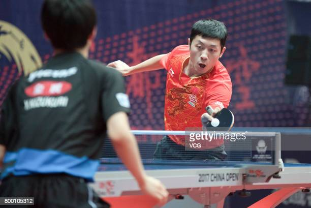 Xu Xin of China competes during the men's doubles semifinal match against Tomokazu Harimoto and Yuto Kizukuri of Japan on the day two of the 2017...