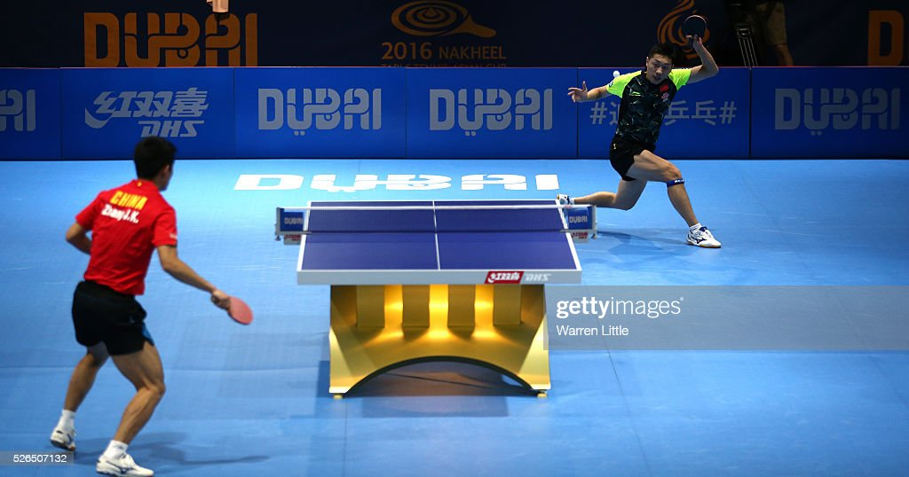 Xu Xin of China in action against Zhang Jike of China during the Men's singles final of the Nakheel Table Tennis Asian Cup 2016 at Dubai World Trade Centre on April 30, 2016 in Dubai, United Arab Emirates.