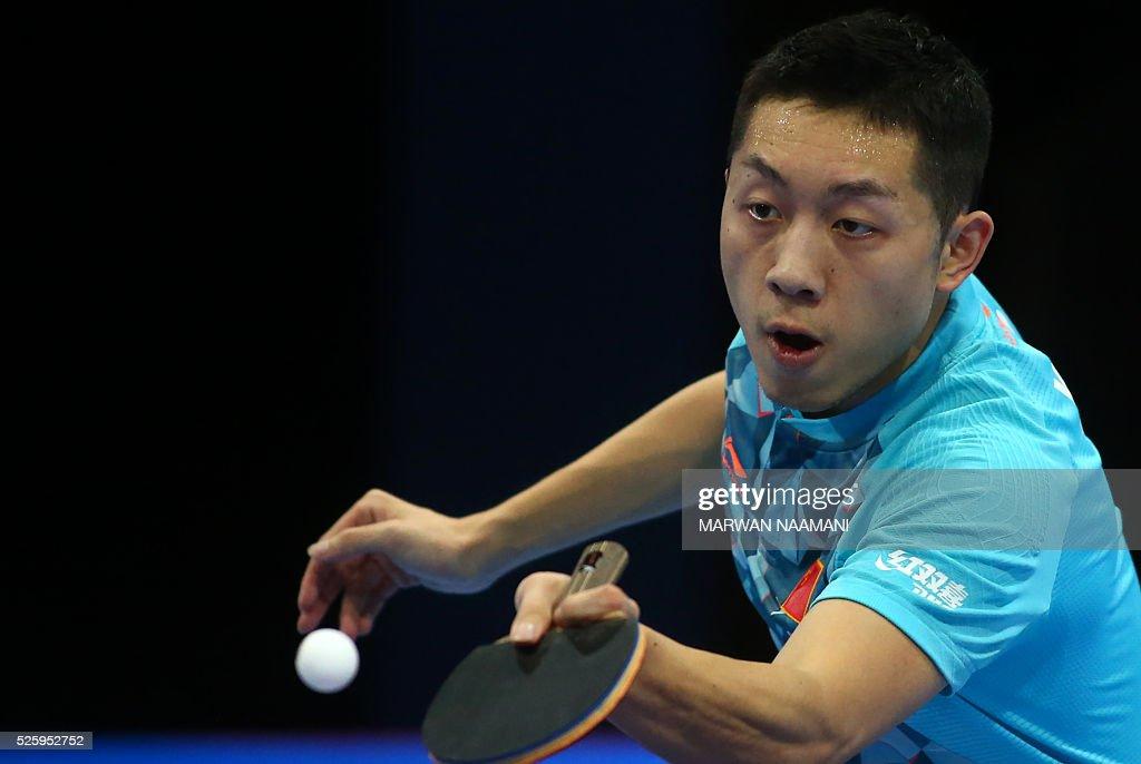 Xu Xin of China returns the ball to Lee Sangsu of Korea during their men's singles quarter final table tennis match in the ITTF Nakheel Table Tennis Asian Cup, in Dubai, on April 29, 2016. / AFP / MARWAN