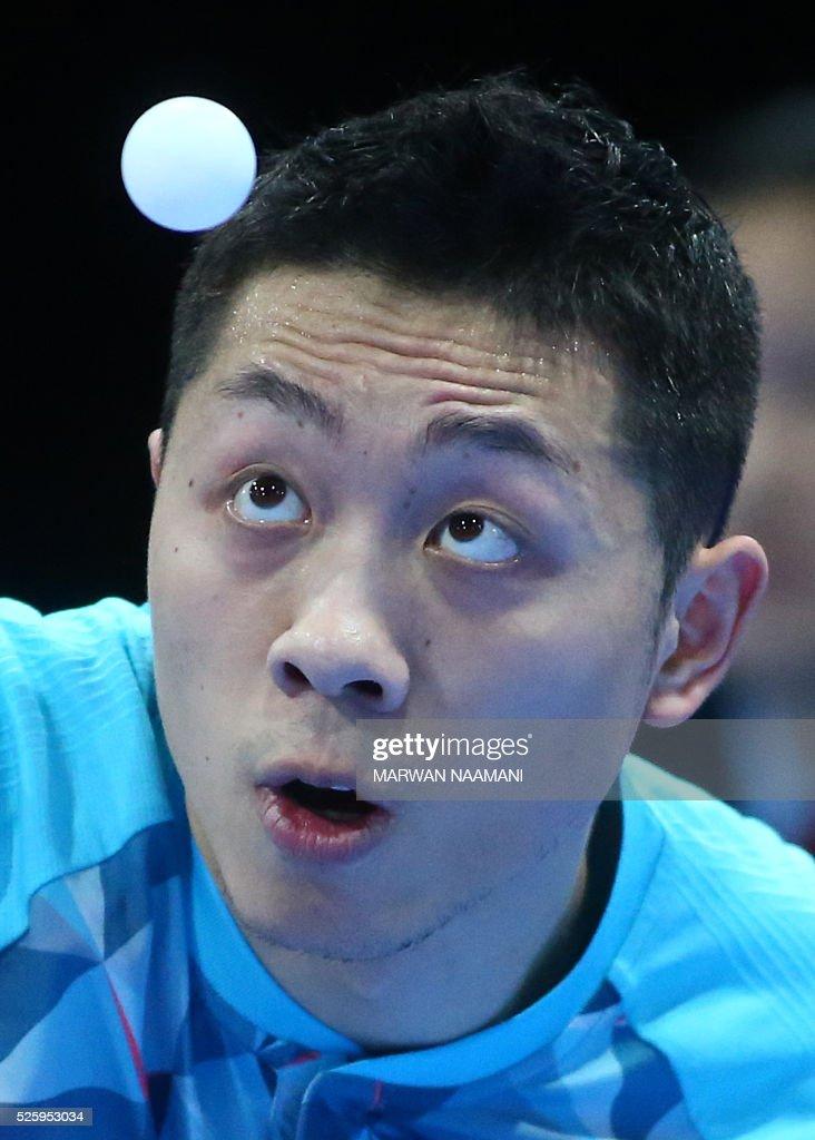 Xu Xin of China serves the ball to Lee Sangsu of Korea during their men's singles quarter final table tennis match in the ITTF Nakheel Table Tennis Asian Cup, in Dubai, on April 29, 2016. / AFP / MARWAN