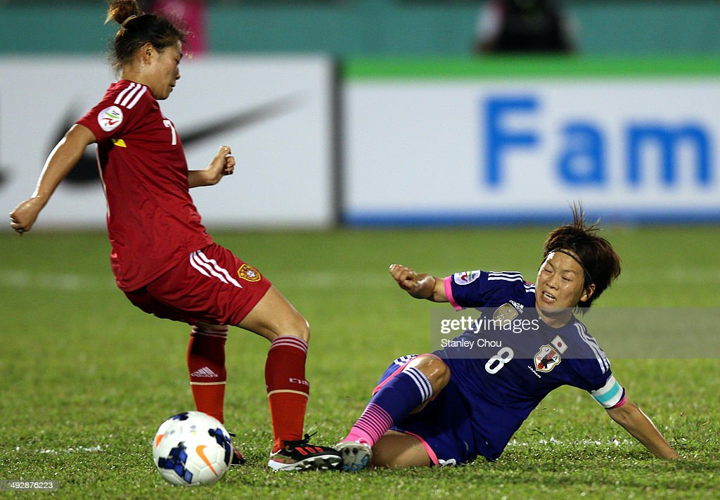 Xu Yanglu of China battles with <a gi-track='captionPersonalityLinkClicked' href=/galleries/search?phrase=Aya+Miyama&family=editorial&specificpeople=2524493 ng-click='$event.stopPropagation()'>Aya Miyama</a> of Japan during the AFC Women's Asian Cup Semi Final match between Japan and China at Thong Nhat Stadium on May 22, 2014 in Ho Chi Minh City, Vietnam.