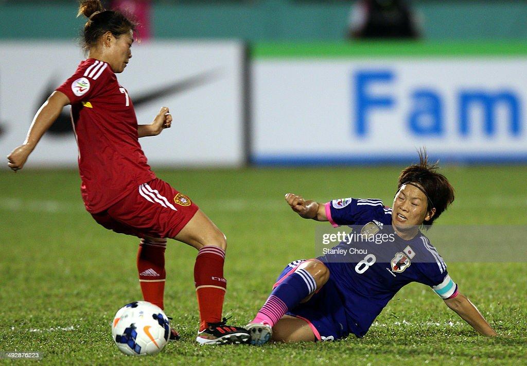 Xu Yanglu of China battles with Aya Miyama of Japan during the AFC Women's Asian Cup Semi Final match between Japan and China at Thong Nhat Stadium on May 22, 2014 in Ho Chi Minh City, Vietnam.