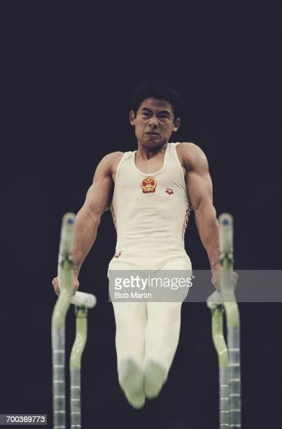 Xu Zhiqiang of China performs during the Men's Parallel Bars on 18 September 1988 during the XXIV Summer Olympic Games at the Olympic Gymnastics Hall...