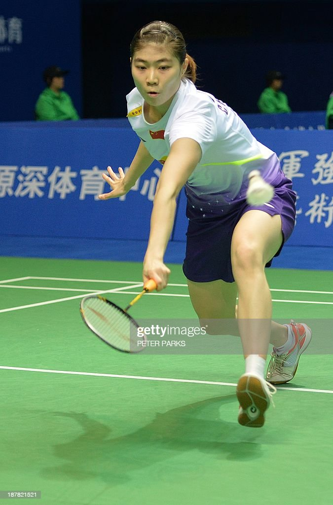 Xuan Deng of China hits a return to Sayaka Takahashi of Japan in the women's singles first round at the China Open badminton tournament in Shanghai on November 13, 2013. Takahashi won the match 21-13, 16-21, 22-20. AFP PHOTO/Peter PARKS