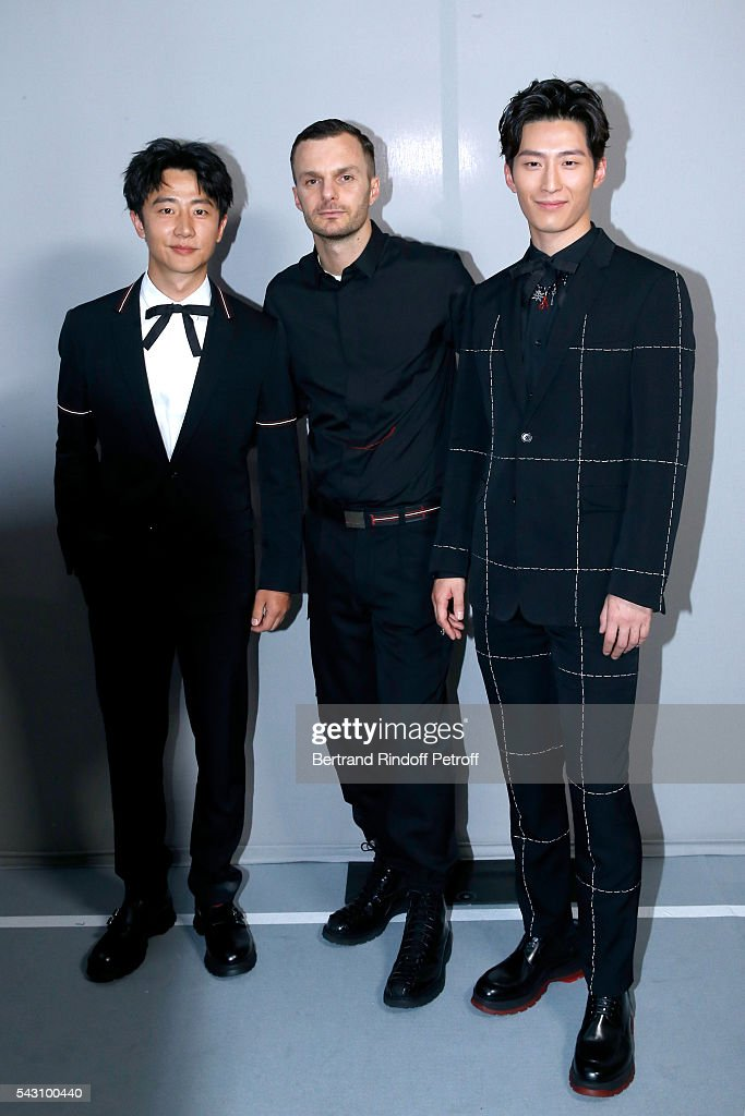 Xuan Huang, Fashion designer Kris Van Assche and Xiao Dou pose Backstage after the Dior Homme Menswear Spring/Summer 2017 show as part of Paris Fashion Week on June 25, 2016 in Paris, France.