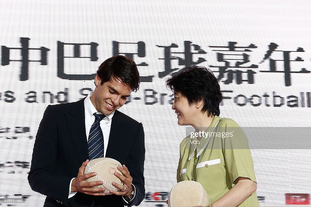 Xue Li (R), Vice Chairman of Chinese Football Association, presents Cuju, an ancient Chinese football, to Real Madrid's Brazilian midfielder Kaka during the Grand Sino-Brazil Cultural and Sports Exchange Activities and Sino-Brazil Football Carnival launching ceremony at National Stadium on July 2, 2013 in Beijing, China.