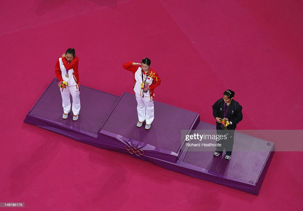 Xuerui Li of China celebrates on the podium with her Gold medal, Yihan Wang of China (L) the Silver and <a gi-track='captionPersonalityLinkClicked' href=/galleries/search?phrase=Saina+Nehwal&family=editorial&specificpeople=729912 ng-click='$event.stopPropagation()'>Saina Nehwal</a> of India (R) the Bronze following the Women's Singles Badminton Gold Medal match on Day 8 of the London 2012 Olympic Games at Wembley Arena on August 4, 2012 in London, England.