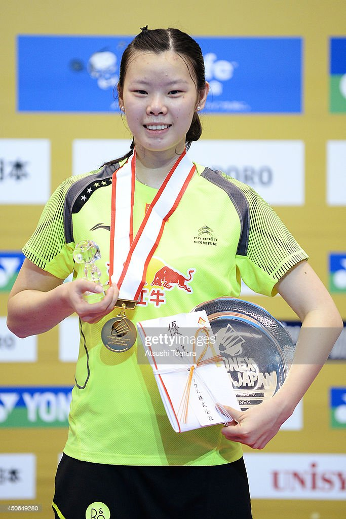 Xuerui Li of China celebrates with the gold medal on the podium during day six of Badminton YONEX Open on June 15, 2014 in Tokyo, Japan.