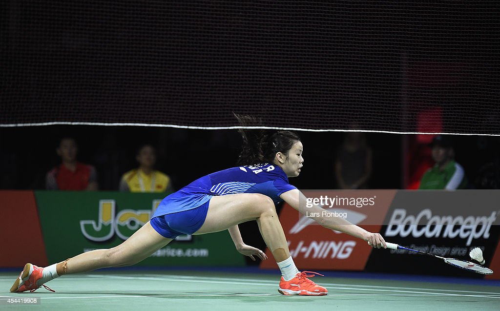 Xuerui Li of China in action in the womens final against Carolina Marin of Spain in the finals during the Li-Ning BWF World Badminton Championships at Ballerup Super Arena on August 31, 2014 in Copenhagen, Denmark.