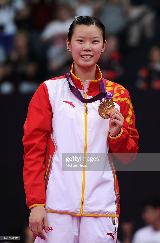 Xuerui Li of China stands on the podium with her Gold medal following the Women's Singles Badminton Gold Medal match on Day 8 of the London 2012 Olympic Games at Wembley Arena on August 4, 2012 in London, England.