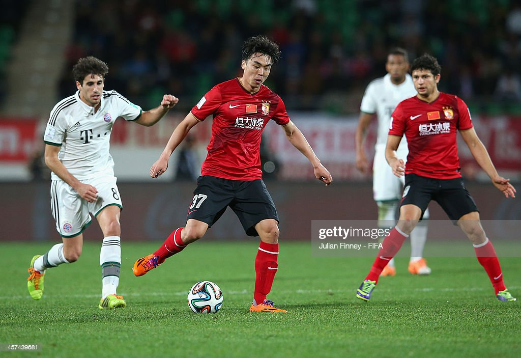 Xuri Zhao of Guangzhou Evergrande FC in action with Javier Martinez of Bayern Muenchen during the FIFA Club World Cup Semi Final match between Guangzhou Evergrande FC and Bayern Muenchen at the Agadir Stadium on December 17, 2013 in Agadir, Morocco.