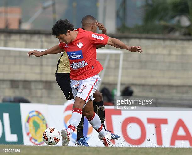 xxx of Itaguí struggles for the ball with xxx of J Aurich during a match between Itaguí and J Aurich as part of the Copa Total Sudamericana at...