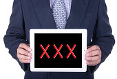 tablet in hands of businessman xxx sexual content