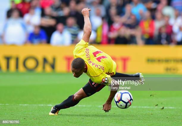 xxxx of Watford tackles xxxx of Liverpool during the Premier League match between Watford and Liverpool at Vicarage Road on August 12 2017 in Watford...
