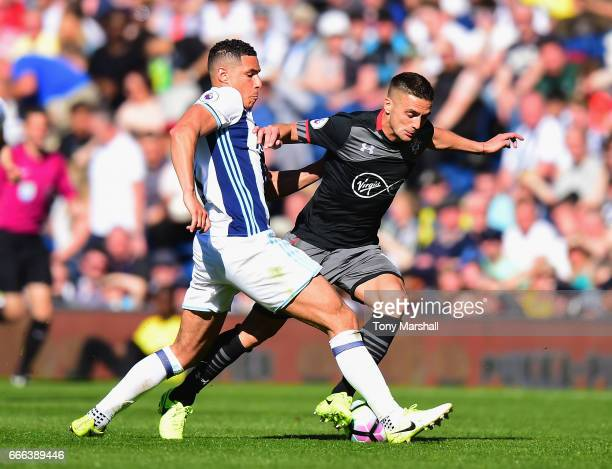 xxxx of West Bromwich Albion is tackled by xxxx of Southampton during the Premier League match between West Bromwich Albion and Southampton at The...